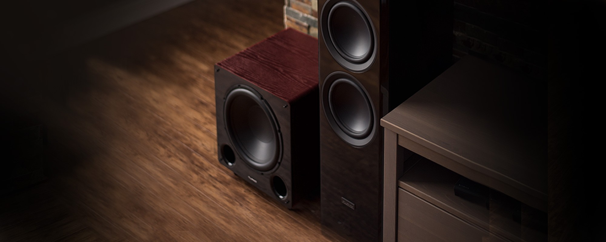 DB12 Mahogany 12-inch Low Frequency Ported Front Firing Powered Subwoofer - Beside TV