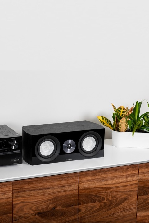 XL8C Center Channel Speaker on cabinet with indoor plant